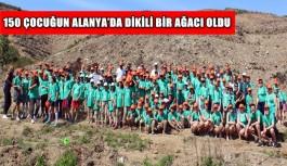 Alanya'da çocuklar hatıra ormanı için fidan dikti