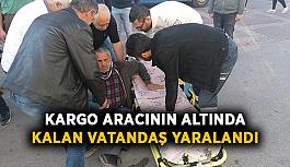 Kargo aracının altında kalan vatandaş yaralandı