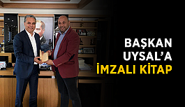 Başkan Uysal'a imzalı kitap