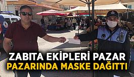 Zabıta ekipleri pazar pazarında maske dağıttı