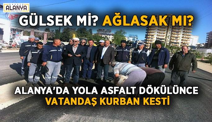 Alanya'da yola asfalt dökülünce vatandaş kurban kesti