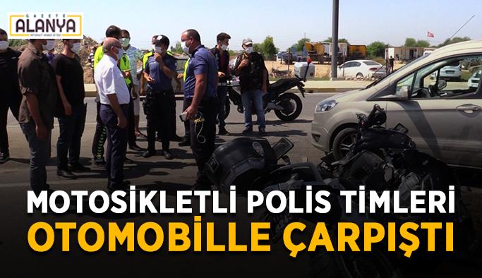 Motosikletli polis timleri otomobille çarpıştı