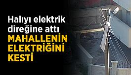 Halıyı elektrik direğine attı, mahallenin elektriğini kesti