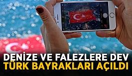 Denize ve falezlere dev Türk bayrakları açıldı
