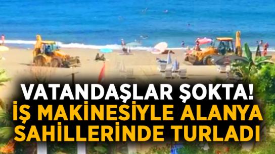 Vatandaşlar şokta! İş makinesiyle Alanya sahillerinde turladı